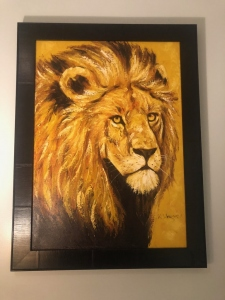 Tanzanian painting of a lion profile. Symbolic of a Defender.