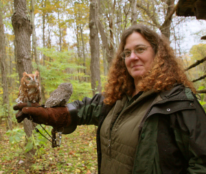 Season {2} Episode {5}: Wendy Perrone Image shows woman holding a screech owl on her arm.