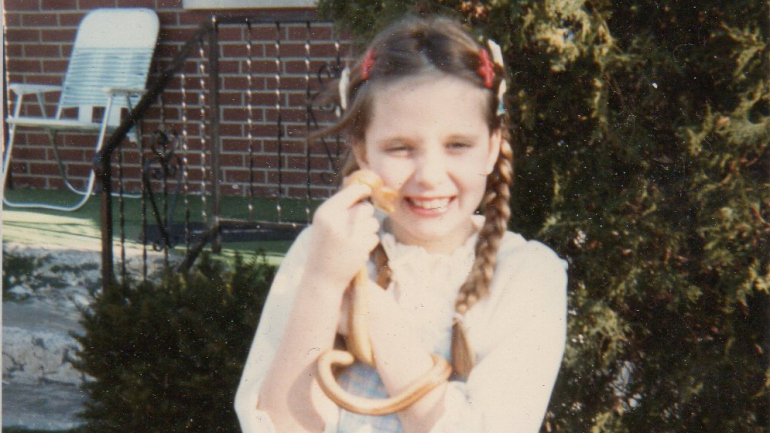 Season {2} Episode {6}: Melissa Amarello Photo of young girl with braids holding a small snake
